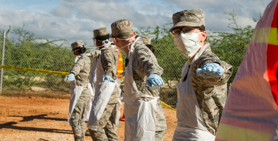 Airman 1st Class Hope Lockwood, 647th Force Support Squadron, lines up with her teammates for a search and recovery sweep during a training event at Joint Base Pearl Harbor-Hickam, Hawaii, Oct. 27, 2017. The team is tasked with recovering remnants of human remains from accident and disaster sites. (U.S. Air Force photo by Tech. Sgt. Heather Redman)