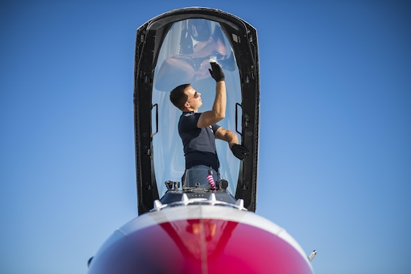 Staff Sgt. Kyle Smith, U.S. Air Force Thunderbird No. 3 assistant dedicated crew chief, cleans condensation off an F-16D Fighting Falcon canopy, Oct. 27, 2017, at Moody Air Force Base, Ga. The Thunderbirds, based out of Nellis AFB, Nev., are the Air Force's premier aerial demonstration team, performing at air shows and special events worldwide. (U.S. Air Force photo by Senior Airman Janiqua P. Robinson)