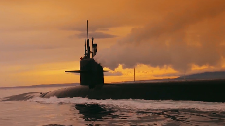 A submarine is at the surface of the water.