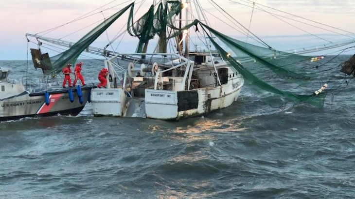 Image of Coast Guard crews assisting a fishing vessel near Ocracoke Island.