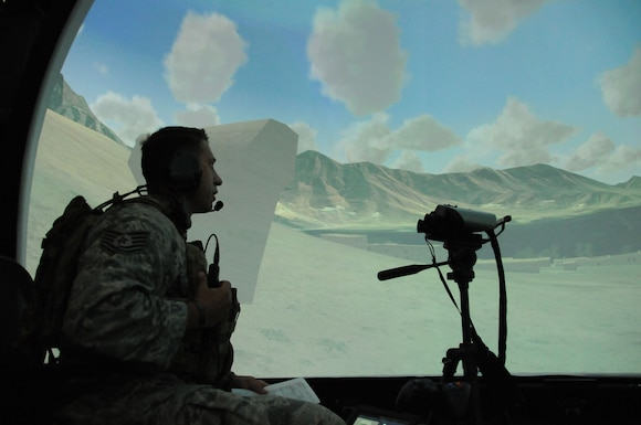 Tech. Sgt. Kole Nail, joint terminal attack controller (JTAC) with the 238th Air Support Operations Squadron, sits in the first-person student station of the Air National Guard advanced JTAC training system (AAJTS) at Key Field Air National Guard Base, Meridian, Miss., June 22, 2017.