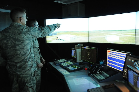 Staff Sgt. Jessie Fairchild, with the 248th Air Traffic Control Squadron (ATCS), trains Airman 1st Class Kyle Austin, an apprentice with the 248th ATCS, on the Tower Simulator System (TSS) at Key Field Air National Guard Base, Meridian, Miss., July 11, 2017.