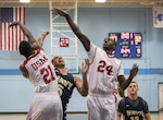 SAN ANTONIO (Nov. 02, 2017) - Members of the U.S. Marine Corps men's basketball team block U.S. Navy Petty Officer Marquel Delancey's shot during a basketball game. The 2017 Armed Forces Basketball Championship is held at Joint Base San Antonio, Lackland Air Force Base from 1-7 November. The best two teams during the double round robin will face each other for the 2017 Armed Forces crown. (U.S. Navy photo by Mass Communication Specialist 2nd Class Emiline L. M. Senn/Released)