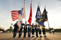 The U.S. Strategic Command's honor guard posts the colors prior to leading members of team Offutt and tenant units in the 2011 Veterans Day parade held on Mission Avenue in Bellevue, Neb.