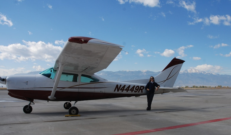 Zoan Harclerode, flight instructor at the Rocky Mountain Flight Training Center on Peterson Air Force Base, Colorado, stands by one of the aircraft she uses to train her students Oct. 31, 2017. Harclerode was named the winner of the Aircraft Owners and Pilots Association National, and Western Region, flight instructor of the year based upon the 2017 Flight Training Experience Survey. (U.S. Air Force photo by Dave Smith)