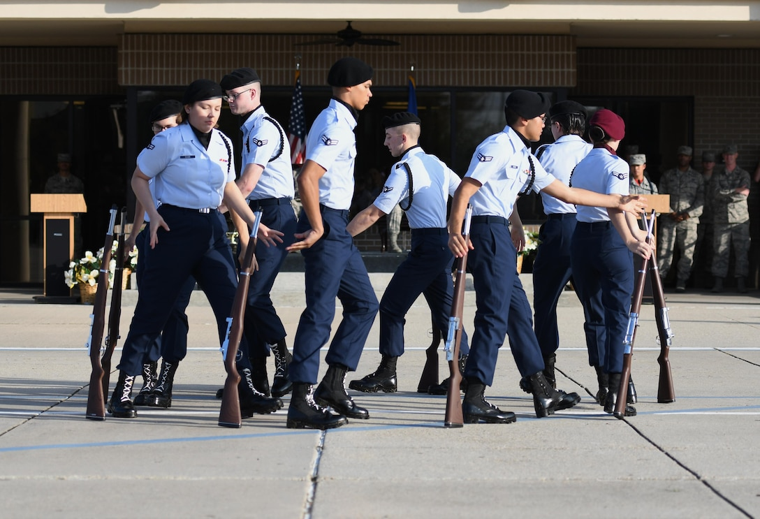 Members of the 335th Training Squadron freestyle drill team perform during the 81st Training Group drill down on the Levitow Training Support Facility drill pad Nov. 3, 2017, on Keesler Air Force Base, Mississippi. Airmen from the 81st TRG competed in the final quarterly open ranks inspection, regulation drill routine and freestyle drill routine. The 338th TRS Dark Knights took first place this quarter, while the 334th TRS Gators took first place for the year. (U.S. Air Force photo by Kemberly Groue)