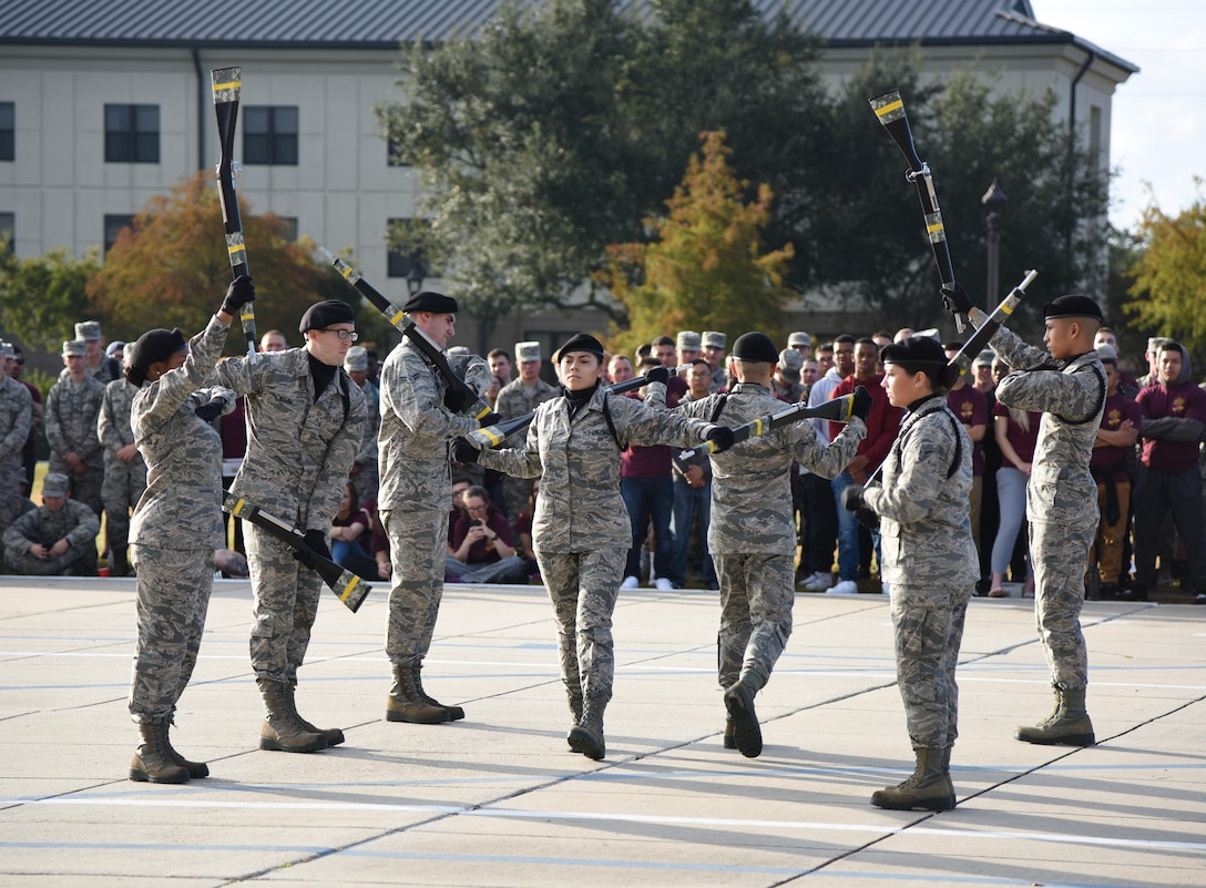 Members of the 334th Training Squadron freestyle drill team perform during the 81st Training Group drill down on the Levitow Training Support Facility drill pad Nov. 3, 2017, on Keesler Air Force Base, Mississippi. Airmen from the 81st TRG competed in the final quarterly open ranks inspection, regulation drill routine and freestyle drill routine. The 338th TRS Dark Knights took first place this quarter, while the 334th TRS Gators took first place for the year. (U.S. Air Force photo by Kemberly Groue)