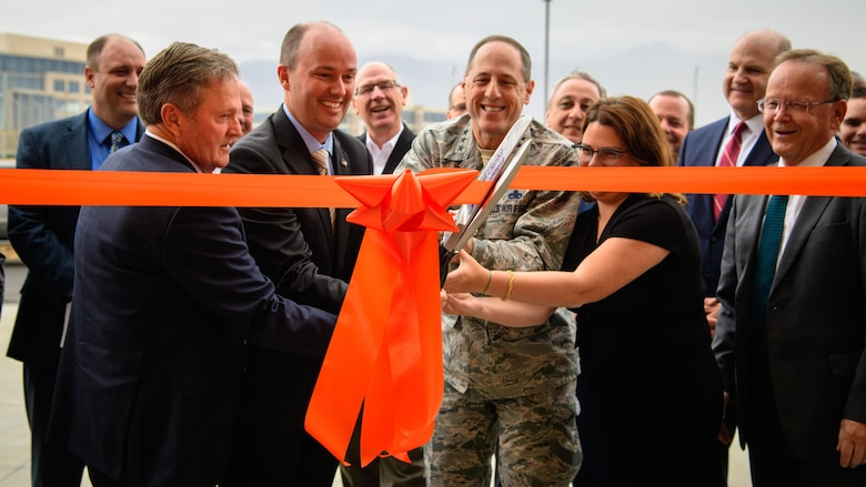 (Left to right) Utah state Sen. Jerry Stevenson, Utah Lt. Gov. Spencer Cox, Lt. Gen. Lee K. Levy II, Air Force Sustainment Center commander, and Dr. Ivy Estabrook, USTAR executive director, cut the ribbon to the newly constructed USTAR Innovation Center located just outside the west gate of Hill Air Force Base, Utah, Nov. 3, 2017. (U.S. Air Force photo by R. Nial Bradshaw)