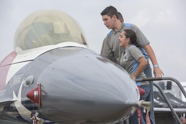 Junior Reserve Officers' Corps cadets look into the canopy of an F-16 Fighting Falcon Nov. 3, 2017, at the 2017 Joint Base San Antonio Air Show and Open House at JBSA-Lackland, Kelly Field, Texas. The Junior Reserve Officer Training Corps is a federal program sponsored by the United States Armed Forces in high schools and also in some middle schools across the United States and United States military bases across the world. (U.S. Air Force photo by Senior Airman Stormy Archer)
