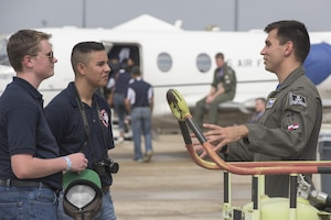 Junior Reserve Officers' Corps cadets speak to a pilot from the 12th Flying Training Wing Nov. 3, 2017, during the 2017 Joint Base San Antonio Air Show and Open House at JBSA-Lackland, Kelly Field, Texas. The Junior Reserve Officer Training Corps is a federal program sponsored by the United States Armed Forces in high schools and also in some middle schools across the United States and United States military bases across the world. (U.S. Air Force photo by Senior Airman Stormy Archer)
