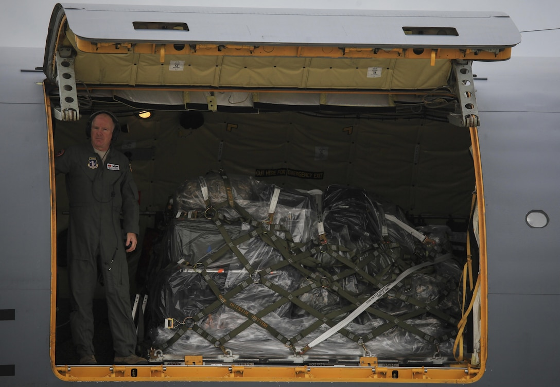 Chief Master Sgt. Brian Kilpatrick closes the cargo door of a 108th Wing KC-135 Stratotanker on Joint Base McGuire-Dix-Lakehurst, N.J., Oct. 16, 2017. The 108th Wing transported soldiers and gear from the New Jersey Army National Guard's 44th Infantry Brigade Combat Team to Puerto Rico to assist in the continued recovery efforts in the wake of Hurricane Maria. (U.S. Air National Guard photo by Master Sgt. Matt Hecht)