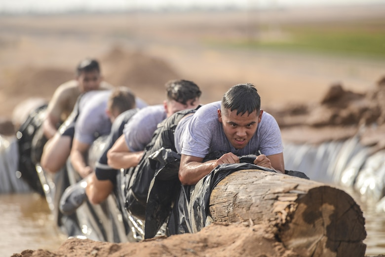 Raymond Romero, Arizona State University ROTC cadet, leads his team over an obstacle during the 4th annual Luke Mudder at Luke Air Force Base, Ariz., Nov. 3, 2017. Working in teams of four, cadets competed for the fastest time in finishing the 17 obstacle, mile and a half course. (U.S. Air Force photo/Airman 1st Class Caleb Worpel)