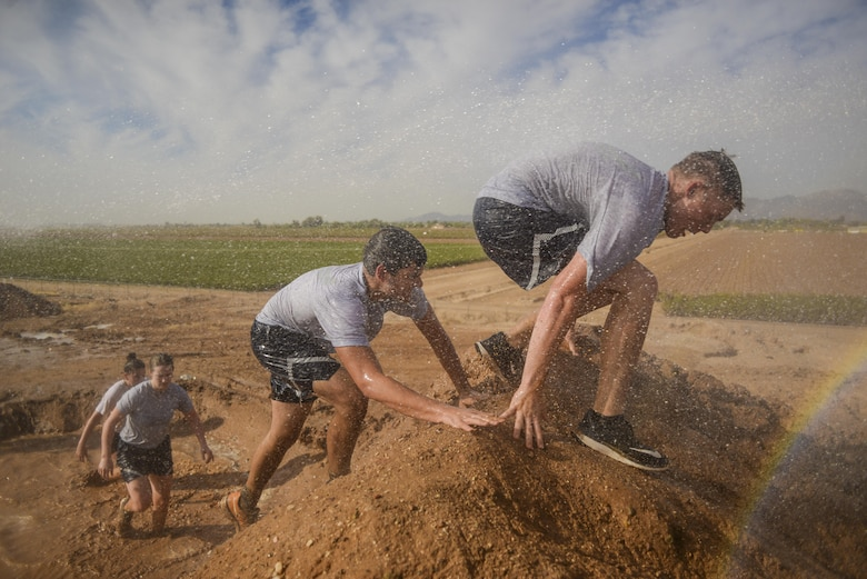 Bryce Mellish, Arizona State University ROTC cadet, swims through a mud trench during the 4th annual Luke Mudder at Luke Air Force Base, Ariz., Nov. 3, 2017. The event was an opportunity for cadets to close their books, get outside, connect with other detachments and start learning about Air Force lifestyle. (U.S. Air Force photo/Airman 1st Class Caleb Worpel)