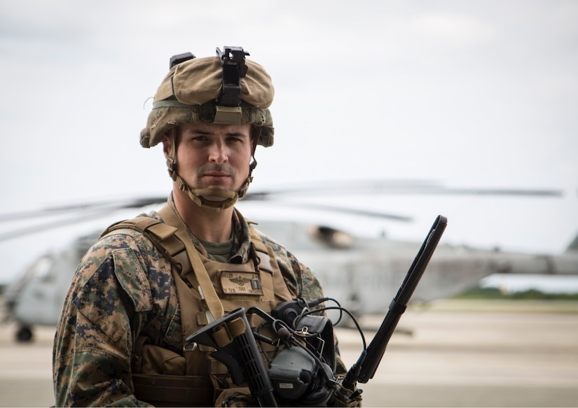 A Marine aviator poses for a photo before participating in Blue Chromite 18.