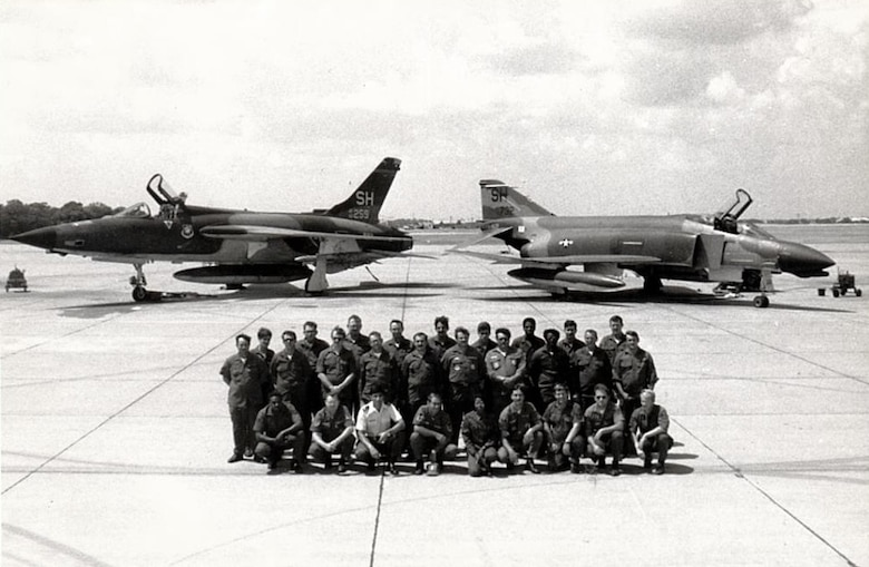 "Members of the 507th Tactical Fighter Group pose for a unit photo in front of the F-105 Thunderchief and F-4 Phantom II during the unit conversion at Tinker Air Force Base, Okla. In 1980, the 507th TFG Okies were re-equipped with the McDonnell Douglas ""Mig Killer"" F-4D fighter aircraft. (U.S. Air Force Photo)"
