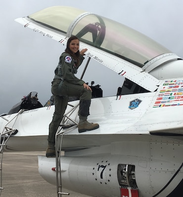 """Brittany Morin, founder and CEO of Brit and Company, gets ready to fly with the U.S. Air Force Aerial Demonstration Squadron """"Thunderbirds"""" at the 2017 Joint Base San Antonio Air Show and Open House Nov. 4, 2017.  Morin got the opportunity to see first-hand the teamwork and precision needed to deliver combat airpower around the world."""