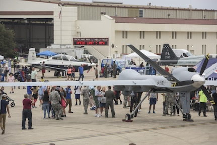 Visitors take in the sights and sound of the 2017 Joint Base San Antonio Air Show and Open House Nov. 4, 2017, at JBSA-Lackland, Kelly Field, Texas. Air shows allow the Air Force to display the capabilities of our aircraft to the American taxpayer through aerial demonstrations and static displays. (U.S. Air Force photo by Senior Airman Stormy Archer)
