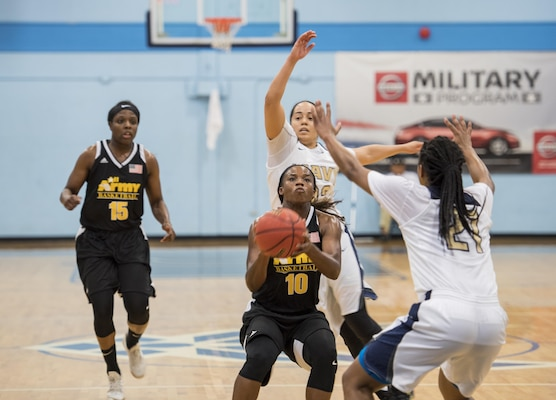 SAN ANTONIO (Nov. 03, 2017) - U.S. Army Sgt. Donita Adams, assigned to the Md. Army National Guard attempts to score during a basketball game. The 2017 Armed Forces Basketball Championship is held at Joint Base San Antonio, Lackland Air Force Base from 1-7 November. The best two teams during the double round robin will face each other for the 2017 Armed Forces crown. (U.S. Navy photo by Mass Communication Specialist 2nd Class Emiline L. M. Senn/Released)