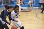 SAN ANTONIO (Nov. 04, 2017) - U.S. Navy Seaman Danika Dale, assigned to VUP-19, Point Magu, Calif., avoids a steal from U.S. Air Force Airman 1st Class Apiphany Woods, assigned to Moody AFB, during a basketball game. The 2017 Armed Forces Basketball Championship is held at Joint Base San Antonio, Lackland Air Force Base from 1-7 November. The best two teams during the double round robin will face each other for the 2017 Armed Forces crown. (U.S. Navy photo by Mass Communication Specialist 2nd Class Christopher Frost/Released)