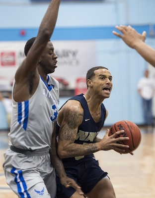 SAN ANTONIO (Nov. 04, 2017) - U.S. Navy Petty Officer 3rd Class Marquel Delancey assigned to Atlantic Area CMD Center, attempts to score during a basketball game. The 2017 Armed Forces Basketball Championship is held at Joint Base San Antonio, Lackland Air Force Base from 1-7 November. The best two teams during the double round robin will face each other for the 2017 Armed Forces crown. (U.S. Navy photo by Mass Communication Specialist 2nd Class Emiline L. M. Senn/Released)