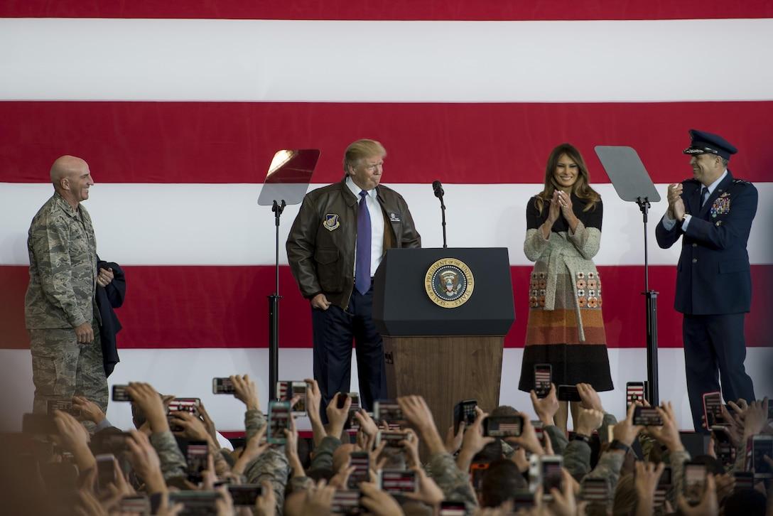 President Donald J. Trump puts on a flight jacket during a Troop Talk, Nov. 5, 2017, at Yokota Air Base, Japan.