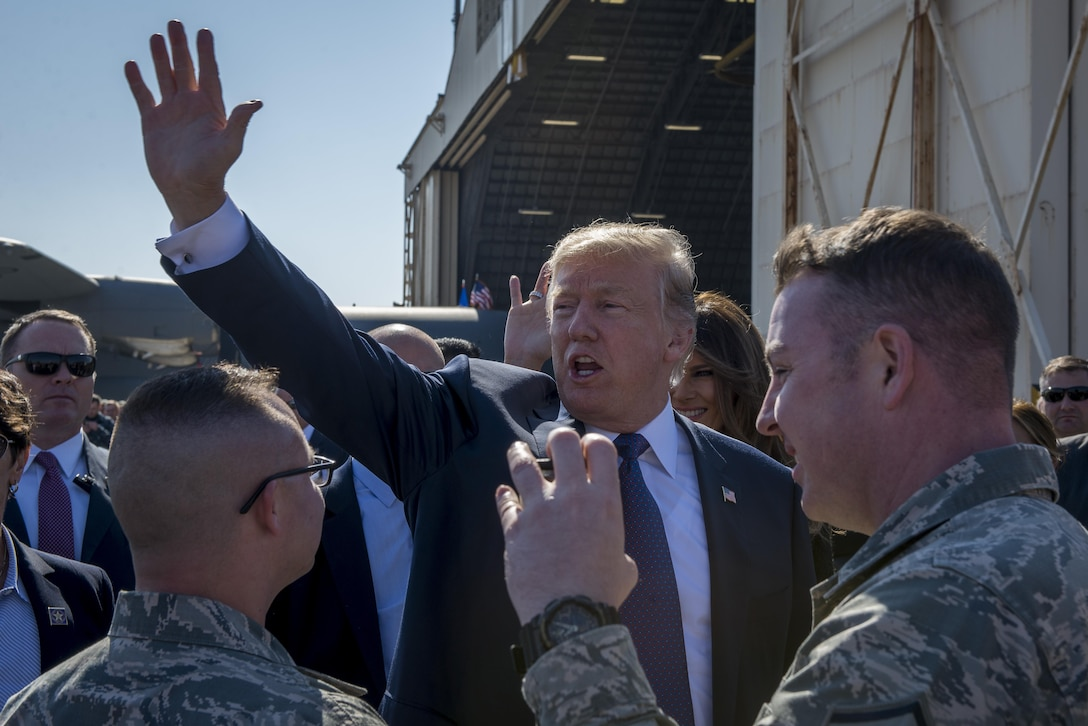 President Donald J. Trump waves to service members and their families upon arriving to Japan, Nov. 5, 2017, at Yokota Air Base, Japan.