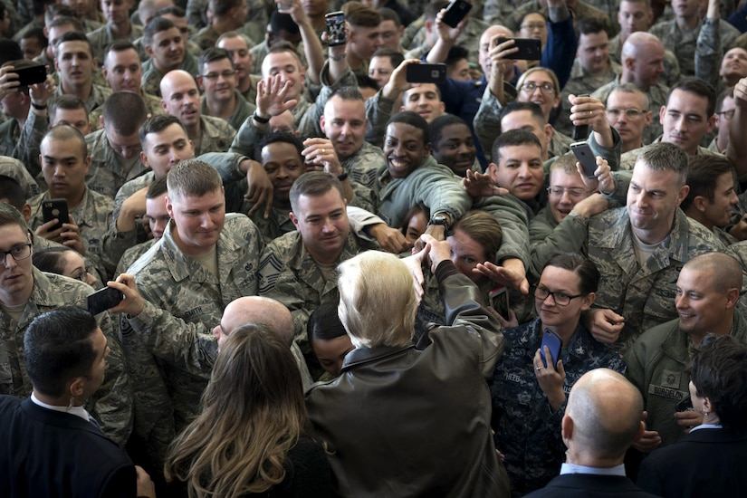 The president and first lady greet service members.