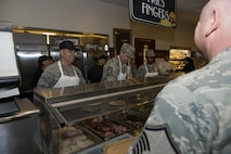 Wing leadership serves Thanksgiving meal