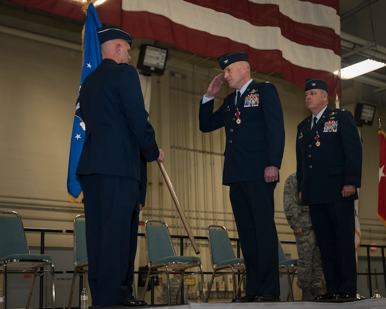 U.S. Air Force Col. Daniel McDonough, center, receives command of the 182nd Airlift Wing, Illinois Air national Guard, from Maj. Gen. Ron Paul, the assistant adjutant general – Air of the Illinois National Guard, during a change of command in Peoria, Ill., Nov. 4, 2017. McDonough replaced Col. William Robertson, right, who became the chief of staff for the Illinois Air National Guard upon his promotion to brigadier general during the ceremony. (U.S. Air National Guard photo by Tech. Sgt. Lealan Buehrer)