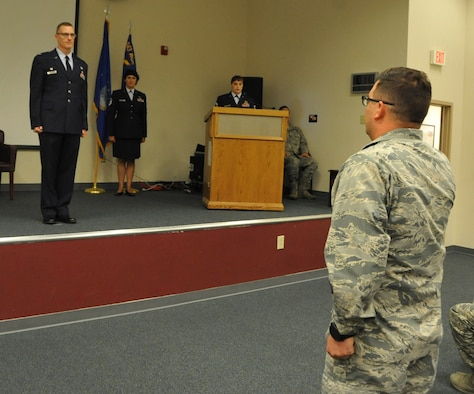 Colonel Buterbaugh stands at attention during assumption of command