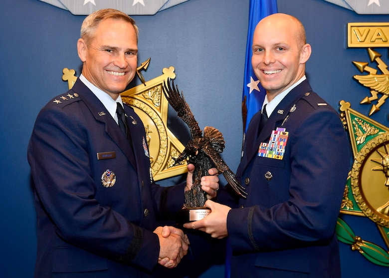 Lt. Gen. Mark C. Nowland, deputy chief of staff for operations, Headquarters U.S. Air Force, Washington, D.C., presents the Special Tactics Officer of the Year Award to 1st Lt. Bryan Hunt, a special tactics officer from the Kentucky Air National Guard's 123rd Special Tactics Squadron, during a ceremony at the Pentagon in Washington, D.C. on Aug. 24, 2017. Hunt is the first Air Guardsman to receive the award. (U.S. Air Force photo by Scott M. Ash)