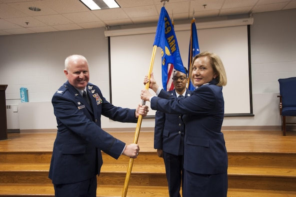 Col. Thomas Pemberton, commander of the 459th Operations Group and Col. Linda Lindberg, commander of the 459th Aeromedical Evacuation Squadron, pose for a picture during a change of command ceremony at Joint Base Andrews, Md., Nov. 5, 2017. Lindberg assumed command of the 459 AES and is joining the unit from the 349 AES at Travis Air Force Base, Calif. (U.S. Air Force photo by Senior Airman Andreaa Phillips)