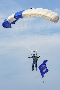 Maj. Chase Skully, Wings of Blue member and 98th Flying Training Squadron assistant director of operations, parachutes into the 2017 Joint Base San Antonio Air Show and Open House Nov. 5, 2017, at JBSA-Lackland, Kelly Field, Texas. Since the team's inception, the Wings of Blue has produced four team members who have become astronauts, ten team members who have become General officers, and countless other professional officers and business professionals; that's in addition to the team members that have become national and world skydiving champions. (U.S. Air Force photo by Senior Airman Stormy Archer)
