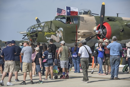 Visitors look at a static aircraft display at the 2017 Joint Base San Antonio Air Show and Open House Nov. 5, 2017, at JSBA-Lackland, Kelly Field, Texas. Air Shows allow the Air Force to display the capapbilities of our aircraft to the American Public through aerial demonstration and static displays. (U.S. Air Force photo by Senior Airman Stormy Archer)