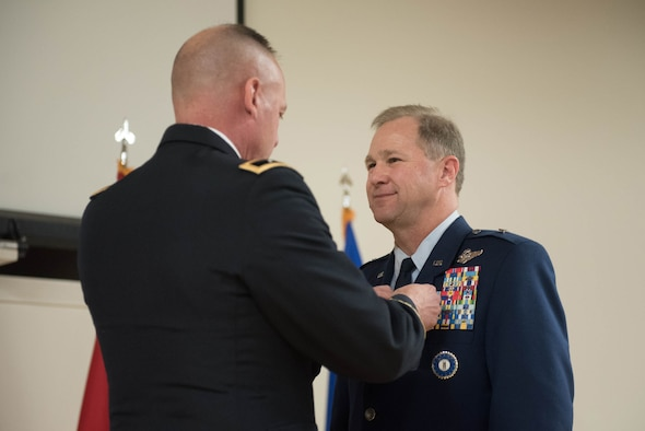 Army Maj. Gen. Stephen Hogan (left), adjutant general for the Commonwealth Kentucky, pins the Meritorious Service Medal onto Brig. Gen. Steven P. Bullard (right), the outgoing chief of staff, Headquarters, Kentucky Air National Guard, during Bullard's retirement ceremony at the Kentucky Air National Guard Base in Louisville, Ky., on Oct. 22, 2017. Bullard is retiring after more than 30 years of service. (U.S. Air National Guard photo by Staff Sgt. Joshua Horton)