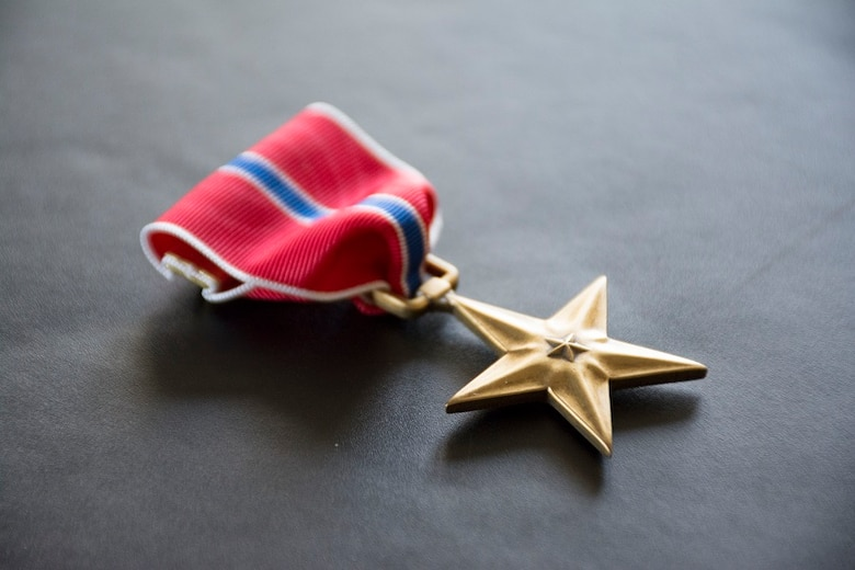 The Bronze Star, depicted here, is authorized by Executive Order No. 9419 on Feb. 4, 1944, and is awarded to a person in any branch of the military service who, while serving in any capacity with the armed forces of the United States on or after Dec. 7, 1941, who shall have distinguished him or her self by heroic or meritorious achievement or service, not involving participation in aerial flight, in connection with military operations against an armed enemy. (U.S. Air Force Photo/Maj. Jon Quinlan)
