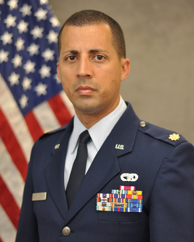 Maj. Damien Miller, 507th Logistics Readiness Squadron commander poses for his official photo here June 15, 2017. (U.S. Air Force Photo)