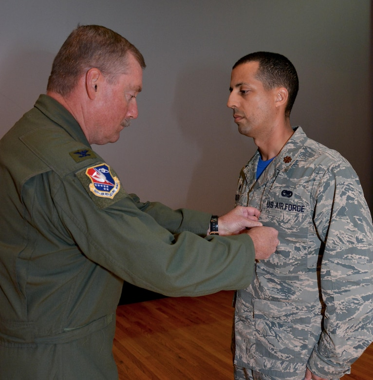 Maj. Damien Miller, 507th Logistics Readiness Squadron commander, receives the Bronze Star Medal from Col. Doug Gullion, 507th Air Refueling Wing commander, during a medal presentation here, Nov. 5, 2017. Miller received the medal for meritorious service in Iraq from Jan. 7 to July 8, 2017, while serving as the 442nd Air Expeditionary Squadron commander. Miller commanded all six coalition aerial ports within Iraq to transport 33,600 tons of cargo and 37,800 passengers on more than 4,500 missions. (U.S. Air Force Photo/Tech Sgt. Samantha Mathison)