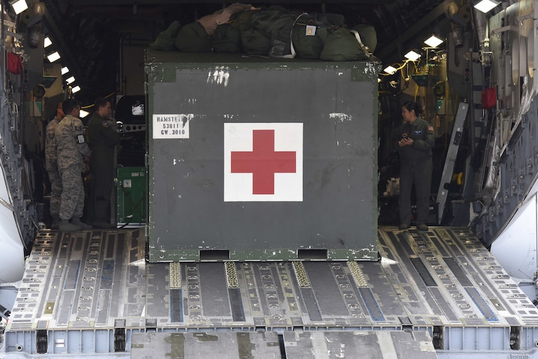 Deployed U.S. Airmen assigned to the 10th Expeditionary Aeromedical Evacuation Squadron, and the 86th Aeromedical Evacuation Squadron prepare for the arrival of injured service members on the Ramstein Air Base, Germany, Oct. 26, 2017. The two squadrons are responsible for patient safety and upkeep while traveling from Europe to the U.S.
