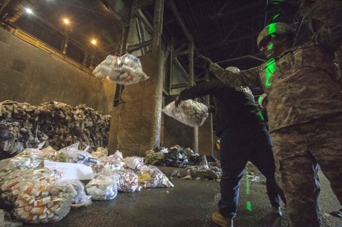 Drug Enforcement Administration agents and soldiers dumped prescription drugs to be incinerated at the Covanta Essex Resource Recovery Facility.
