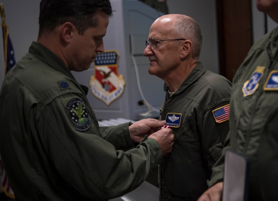 Chief Master Sgt. Dave Boyles receives an award for service during a retirement ceremony held in his honor Nov. 4, 2017 at McLaughlin Air National Guard Base, Charleston, W.Va.