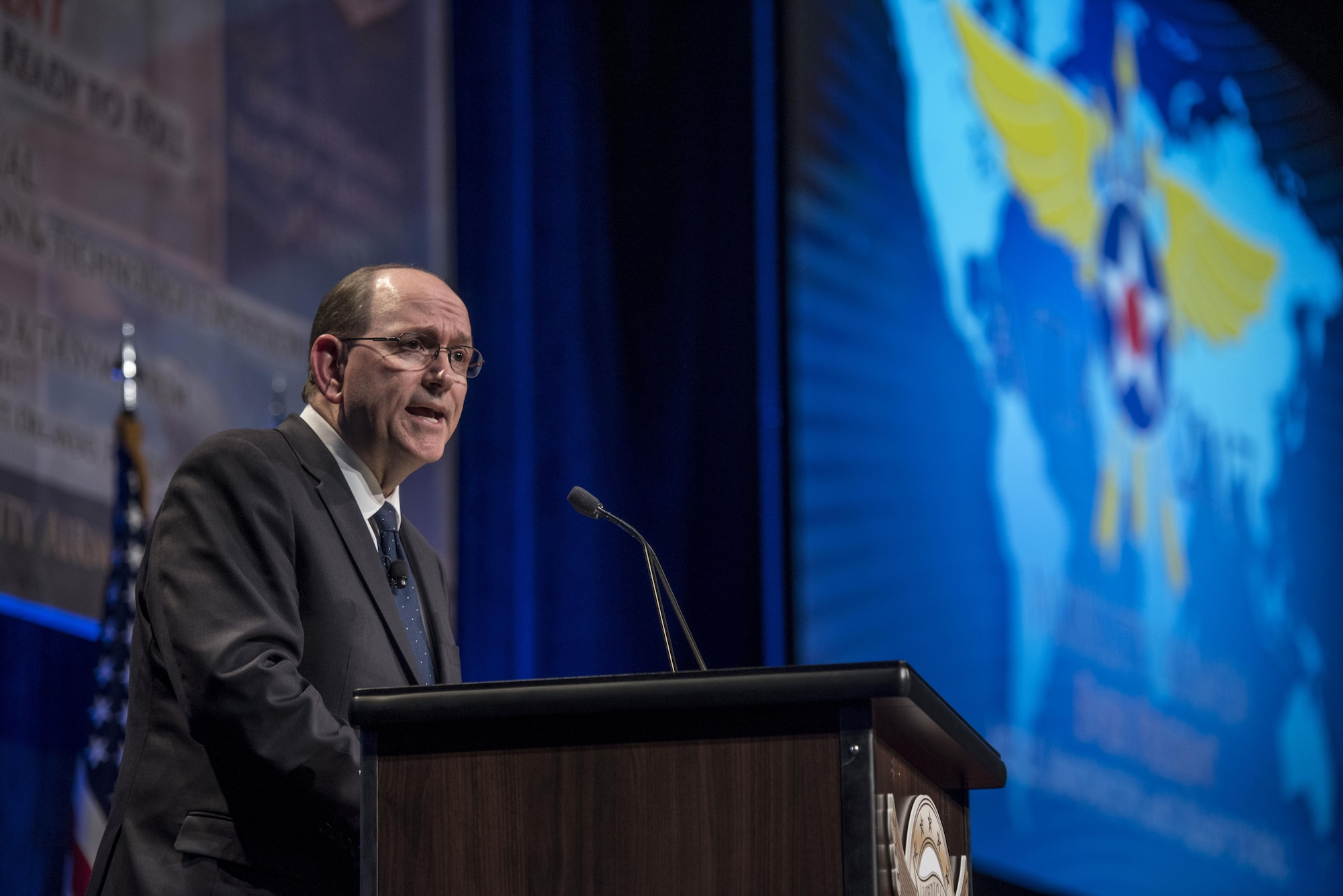 """Under Secretary of the Air Force Matthew Donovan speaks at the Airlift/Tanker Association and Air Mobility Command Symposium in Orlando, Fla., Oct. 26, 2017. This year's conference theme, """"Mobility Airmen: Agile, Innovative and Ready to Roll,"""" provides Air Force leadership, industry experts, and academia an opportunity to work together with current and former Mobility Airmen from around the world to discuss issues and challenges facing America and the Air Mobility community. A/TA provides leadership the opportunity to better understand the impact that more than 124,000 Total Force Mobility Airmen have on the global mobility mission. (U.S. Air Force photo by Tech. Sgt. Jodi Martinez)"""