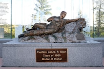 The Lance P. Sijan bronze statue is displayed at the U.S. Air Force Academy. Sijan was the first USAFA graduate to receive the Medal of Honor.