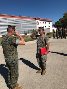 Sgt. Rene Puga-Perea, platoon guide, 2nd platoon, Charlie Co., Fleet Anti-terrorism Security Team, Europe, receives the Navy and Marine Corps Achievement Medal for outstanding performance at Naval Station Rota, Spain, Oct. 27.