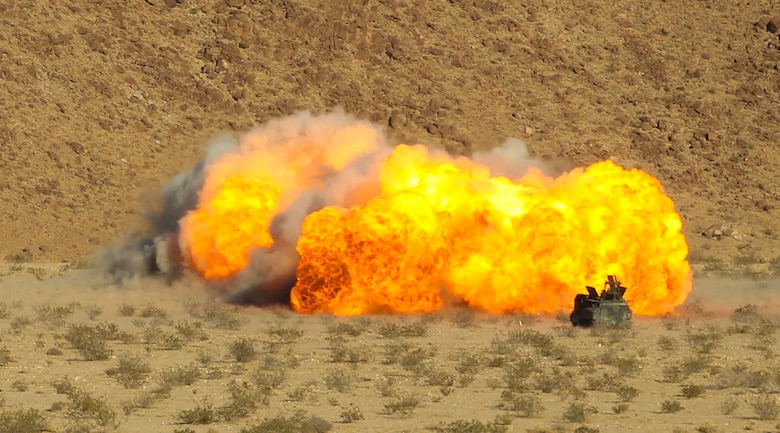 An Amphibious Assault Vehicle fires a Mine Clearing Line Charge from the Mark-154 Mod 1 Launcher at Range 114 aboard the Marine Corps Air Ground Combat Center, Twentynine Palms, Calif., Oct. 26, 2017. Unlike current amphibious breaching systems, the MICLIC will allow a breach lane that provides maneuverability for assault forces as they push forward to provide fire and maneuver on enemy defended beaches that are manned with explosives. (U.S. Marine Corps photo by Cpl. Christian Lopez)