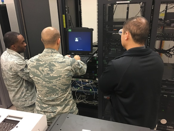 Members of the 26th Network Operations Squadron perform maintenance on an Air Force gateway server Nov. 2, 2017, at Maxwell Air Force Base-Gunter Annex, Alabama. While the migration to the Joint Regional Security Stacks will transition ownership of security architecture from the Air Force to Defense Information Systems Agency, the 26th NOS will retain operational control of traffic flow for Air Force networks. (U.S. Courtesy photo)