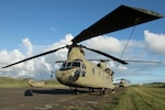 A CH-47 Chinook helicopter sits on the airfield at Roosevelt Roads, Puerto Rico, Nov. 2, 2017. Chinooks are being used to deliver aid to the worst-hit and most remote areas of Puerto Rico as part of the ongoing relief and recovery efforts after the island territory was hit by Hurricanes Irma and Maria. Army photo by Spc. Samuel D. Keenan