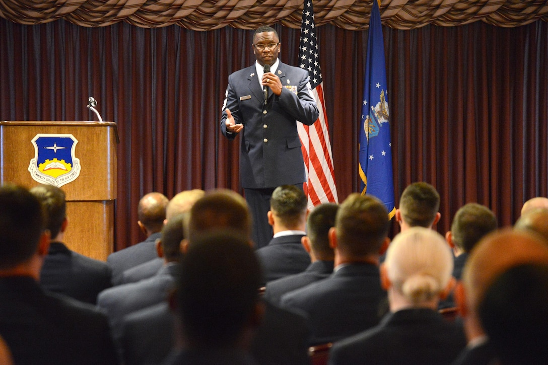 Chief Master Sgt. Paul Thomas, superintendent of the 72nd Medical Group, was the guest speaker at the Community College of the Air Force Graduation held in the Tinker Club Oct. 27.