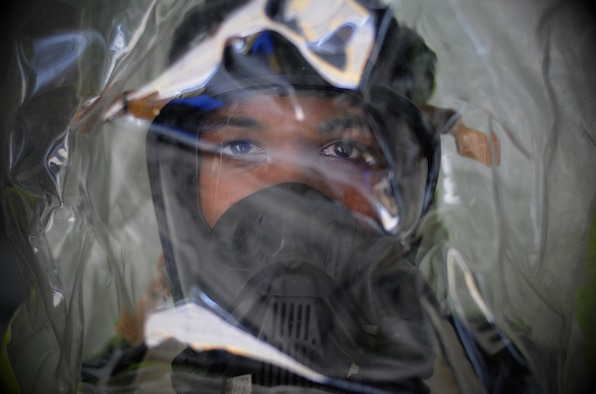 Senior Airman Devin Harris, 81st Aerospace Medicine Squadron bioengineering technician, poses for a photo wearing a hazardous material suit Nov. 1, 2017, on Keesler Air Force Base, Mississippi. The eight-man 81st AMDS Bioenvironmental team performs routine water checks, noise screenings, respiratory fit tests and ventilation tests along with HAZMAT emergency response to prevent occupational health hazards on Keesler AFB. (U.S. Air Force photo by Senior Airman Holly Mansfield)