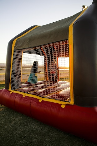 Patrons of the Marine Corps Air Ground Combat Center, Twentynine Palms, Calif., attend the annual Jack-O-Lantern Jubilee at Del Valle Field aboard the Combat Center, Oct. 27, 2017. The event was provided for members of the Combat Center community to enjoy as well as to promote preventative services offered through the Behavioral Health Branch. (U.S. Marine Corps photo by Lance Cpl. Margaret Gale)